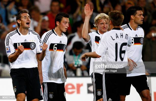 Miroslav Klose of Germany celebrates scoring his team's second goal with teammates Mesut Oezil Andreas Beck Philipp Lahm and Michael Ballack during...