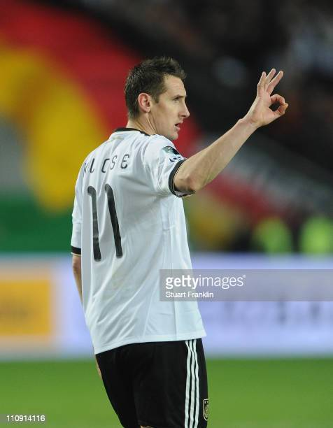 Miroslav Klose of Germany celebrates scoring the fourth goal during the EURO 2012 Group A qualifier match between Germany and Kazakhstan at...