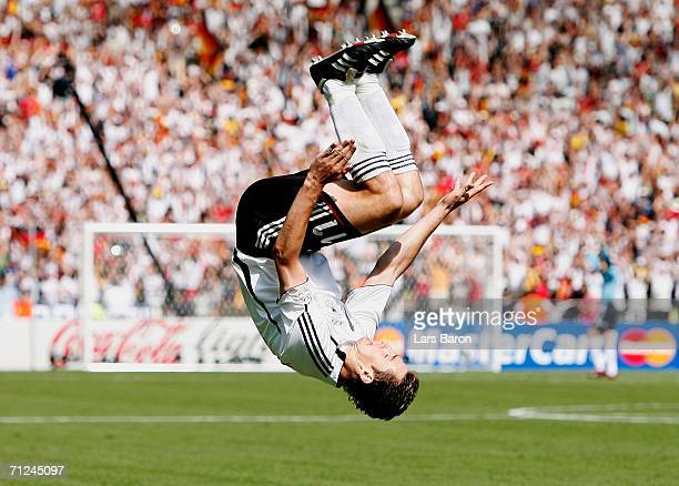 Miroslav Klose of Germany celebrates scoring the opening goal during the FIFA World Cup Germany 2006 Group A match between Ecuador and Germany played...