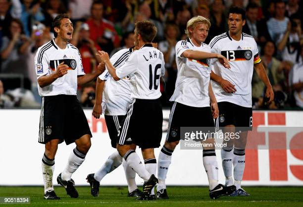Miroslav Klose of Germany celebrates scoring the second goal with Mesut Oezil Philipp Lahm Andreas Beck and Michael Ballack during the FIFA 2010...