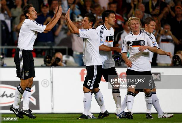 Miroslav Klose of Germany celebrates scoring the second goal with Mesut Oezil Michael Ballack Andreas Beck and Bastian Schweinsteiger during the FIFA...