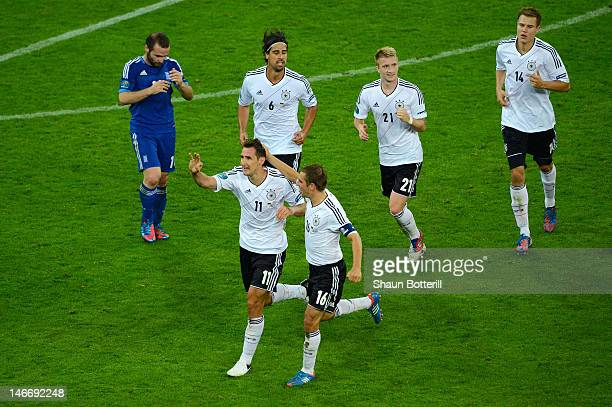 Miroslav Klose of Germany celebrates scoring their third goal with Philipp Lahm during the UEFA EURO 2012 quarter final match between Germany and...