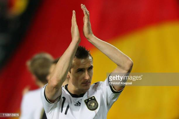 Miroslav Klose of Germany celebrates the 40 victory after the EURO 2012 Group A qualifier match between Germany and Kazakhstan at FritzWalterStadium...