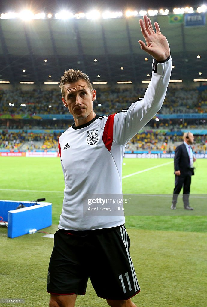 Miroslav Klose of Germany celebrates the 7-1 win while walking off the pitch after the 2014 FIFA World Cup Brazil Semi Final match between Brazil and Germany at Estadio Mineirao on July 8, 2014 in Belo Horizonte, Brazil.