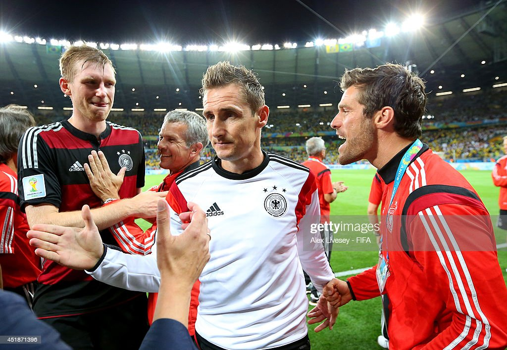 Miroslav Klose (C) of Germany celebrates the 7-1 win while walking off the pitch after the 2014 FIFA World Cup Brazil Semi Final match between Brazil and Germany at Estadio Mineirao on July 8, 2014 in Belo Horizonte, Brazil.