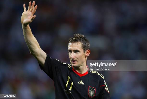 Miroslav Klose of Germany celebrates victory following the 2010 FIFA World Cup South Africa Quarter Final match between Argentina and Germany at...