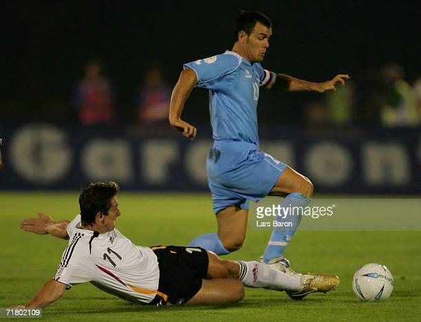 Miroslav Klose of Germany challenges Andy Selva of San Marino for the ball during the UEFA EURO 2008 qualifier between San Marino and Germany at the...