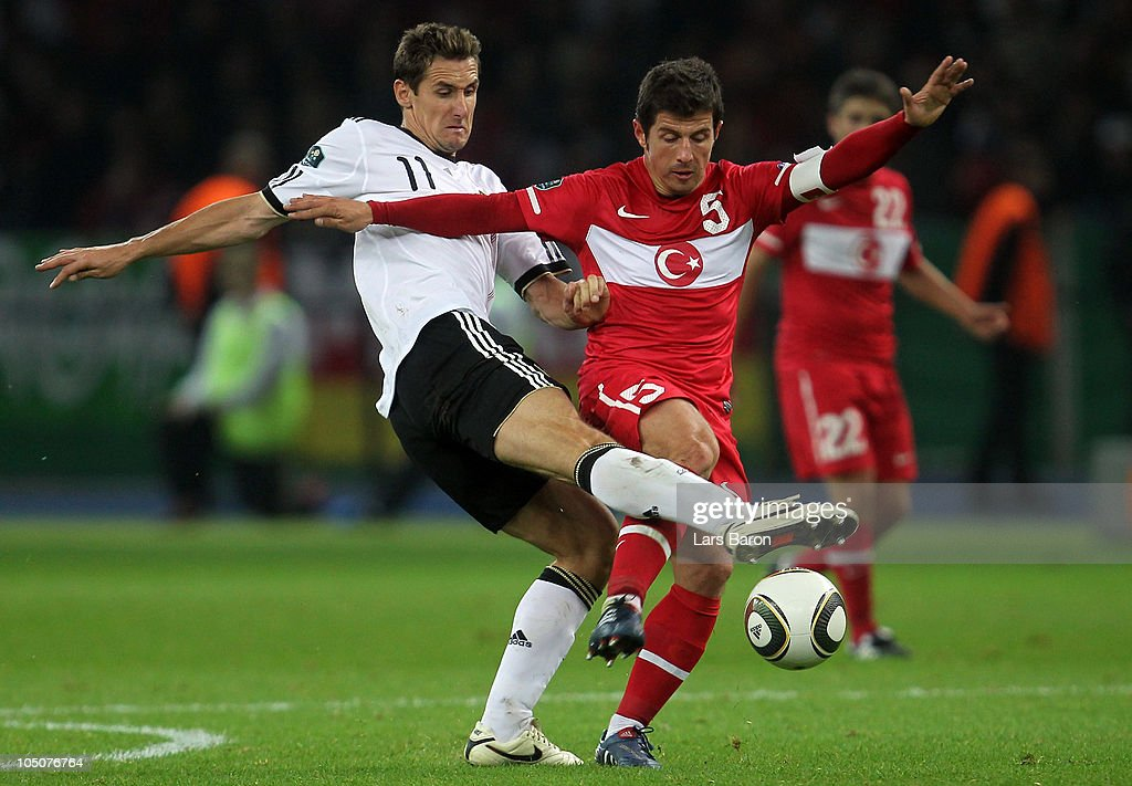 <a gi-track='captionPersonalityLinkClicked' href=/galleries/search?phrase=Miroslav+Klose&family=editorial&specificpeople=206489 ng-click='$event.stopPropagation()'>Miroslav Klose</a> of Germany challenges Emre of Turkey during the EURO 2012 Group A qualifier match between Germany and Turkey at Olympic Stadium on October 8, 2010 in Berlin, Germany.