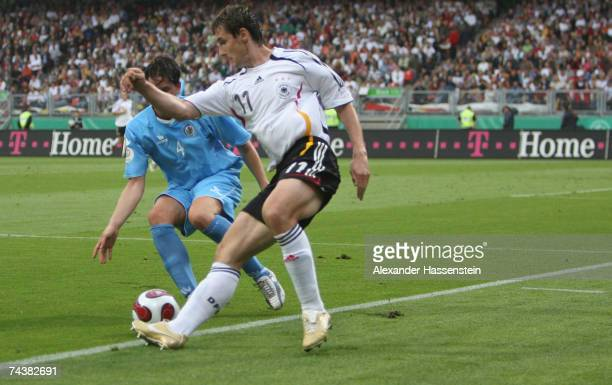 Miroslav Klose of Germany challenges for the ball Nicola Albani of San Marino during the UEFA EURO 2008 qualifier between Germany and San Marino at...
