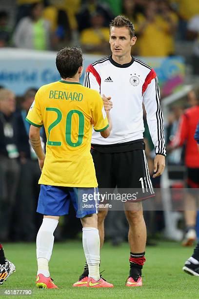 Miroslav Klose of Germany consoles Bernard Anicio Caldeira Duarte of Brazil after the 2014 FIFA World Cup Brazil Semi Final match between Brazil and...