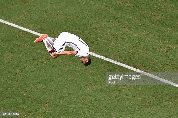 Miroslav Klose of Germany does a flip in celebration of scoring his team's second goal during the 2014 FIFA World Cup Brazil Group G match between...