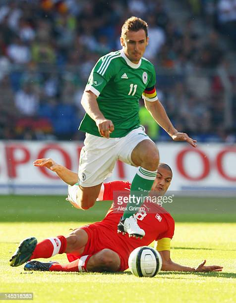Miroslav Klose of Germany eludes Goekhan Inler of Switzerland during the international friendly match between Switzerland and Germany at St JakobPark...