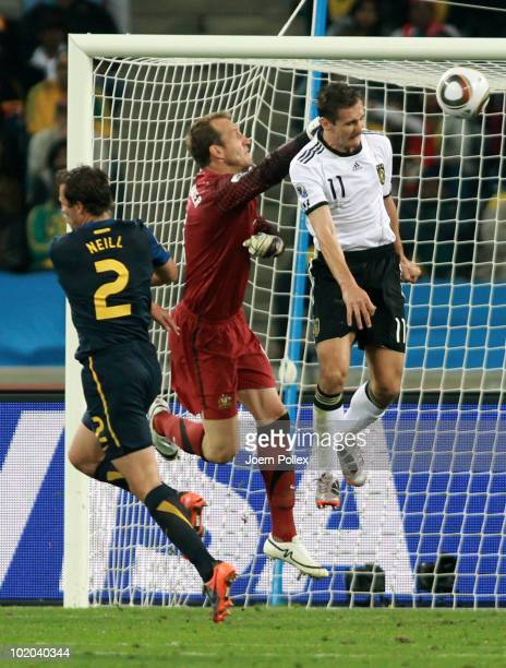 Miroslav Klose of Germany get ahead of Mark Schwarzer of Australia and scores the second goal for Germany during the 2010 FIFA World Cup South Africa...