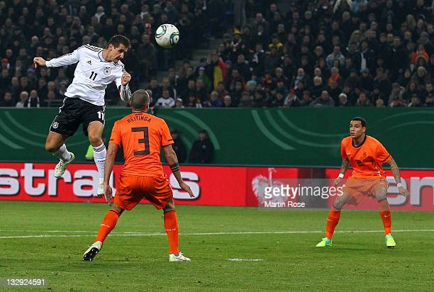 Miroslav Klose of Germany heads his team's second goal during the International friendly match between Germany and Netherlands at Imtech Arena on...