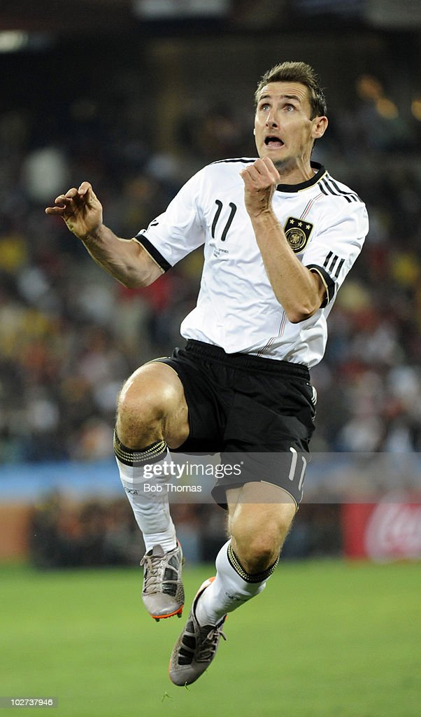 Miroslav Klose of Germany in mid air during the 2010 FIFA World Cup South Africa Semi Final match between Germany and Spain at Durban Stadium on July...