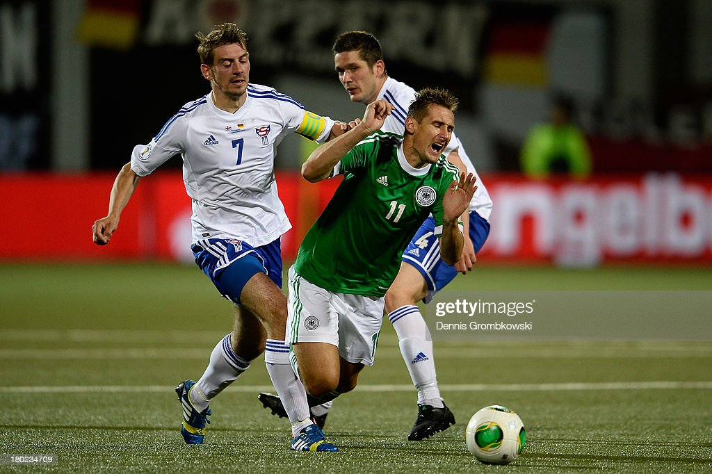 Miroslav Klose of Germany is challenged by Frodi Benjaminsen and Atli Gergersen of Faeroe Islands during the FIFA 2014 World Cup Qualifier match between Faeroe Islands and Germany on September 10, 2013 in Torshavn, Denmark.