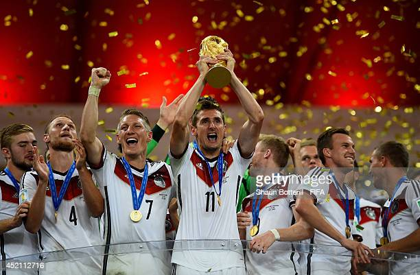 Miroslav Klose of Germany lifts the World Cup to celebrate with his teammates during the award ceremony after the 2014 FIFA World Cup Brazil Final...