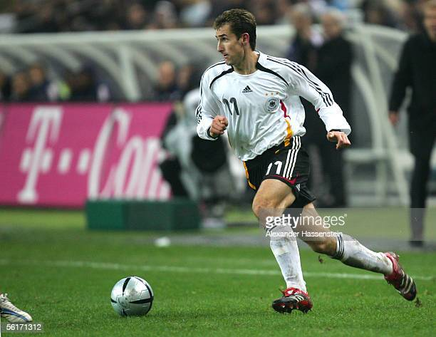Miroslav Klose of Germany runs with the ball during the international friendly match between France and Germany at the Stade de France on November 12...