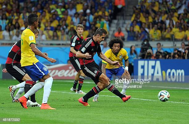 Miroslav Klose of Germany scores his side's second goal during the 2014 FIFA World Cup Brazil Semi Final match between Brazil and Germany at Estadio...