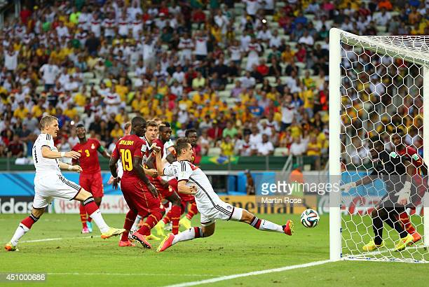 Miroslav Klose of Germany scores his team's second goal past Fatawu Dauda of Ghana during the 2014 FIFA World Cup Brazil Group G match between...