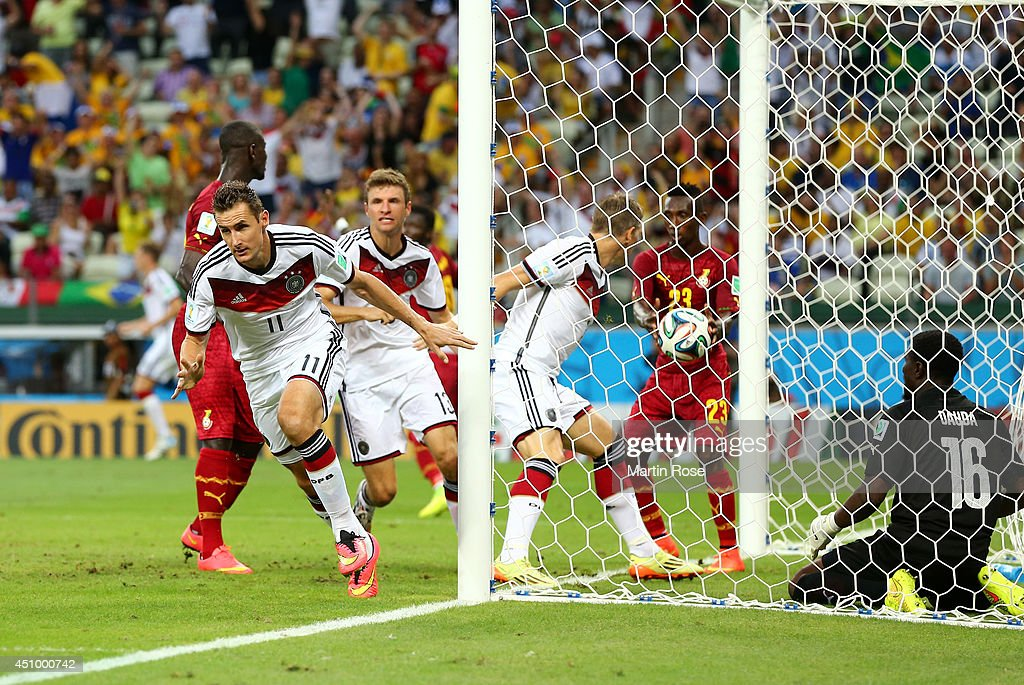 <a gi-track='captionPersonalityLinkClicked' href=/galleries/search?phrase=Miroslav+Klose&family=editorial&specificpeople=206489 ng-click='$event.stopPropagation()'>Miroslav Klose</a> of Germany scores his team's second goal past Fatawu Dauda of Ghana during the 2014 FIFA World Cup Brazil Group G match between Germany and Ghana at Castelao on June 21, 2014 in Fortaleza, Brazil.