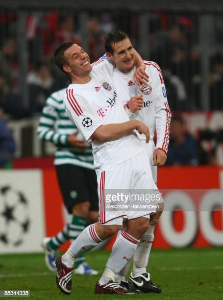 Miroslav Klose of Muenchen celebrates scoring the 8th goal with his team mate Lukas Podolski during the UEFA Champions League first knockout round...