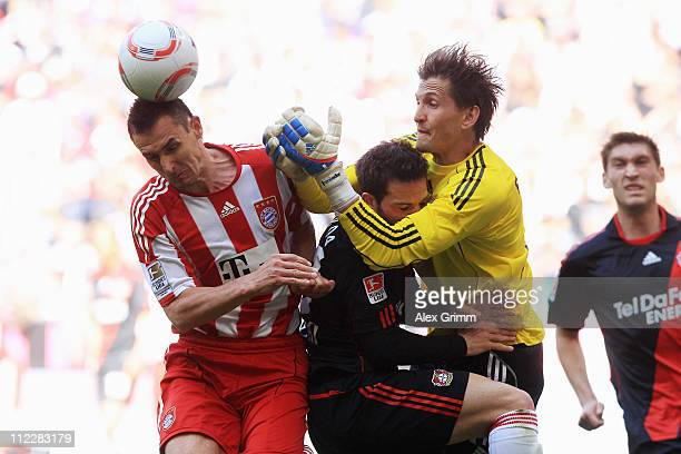Miroslav Klose of Muenchen is challenged by Gonzalo Castro and goalkeeper Rene Adler of Leverkusen during the Bundesliga match between FC Bayern...