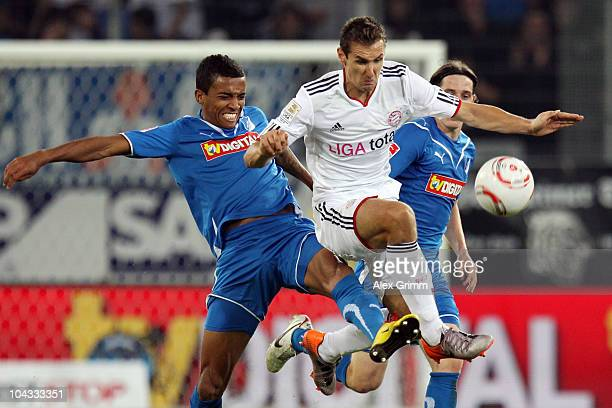 Miroslav Klose of Muenchen is challenged by Luiz Gustavo and Sebastian Rudy of Hoffenheim during the Bundesliga match between 1899 Hoffenheim and FC...