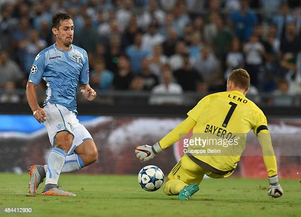 Miroslav Klose of SS Lazio and Bernd Leno of Bayer Leverkusen in action during the UEFA Champions League qualifying round play off first leg match...