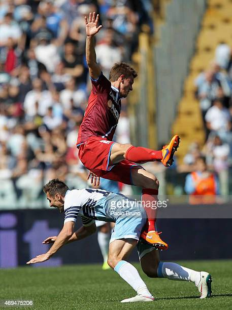 Miroslav Klose of SS Lazio and Daniele Rugani of Empoli FC clash during the Serie A match between SS Lazio and Empoli FC at Stadio Olimpico on April...
