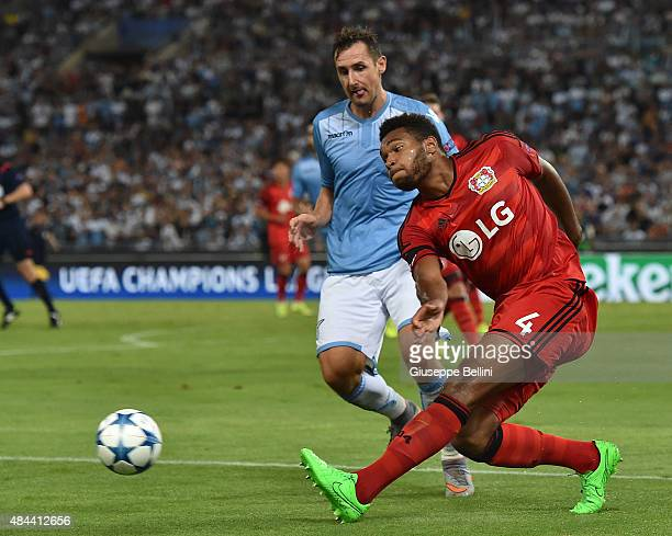 Miroslav Klose of SS Lazio and Jonathan Tah of Bayer Leverkusen in action during the UEFA Champions League qualifying round play off first leg match...