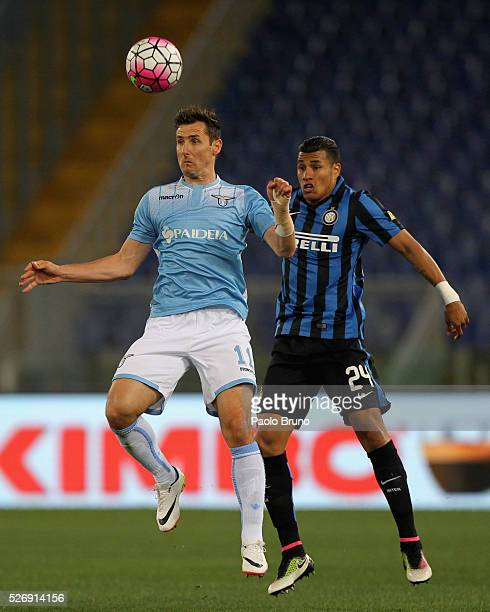 Miroslav Klose of SS Lazio competes for the ball with Jeison Murillo of FC Internazionale Milano during the Serie A match between SS Lazio and FC...