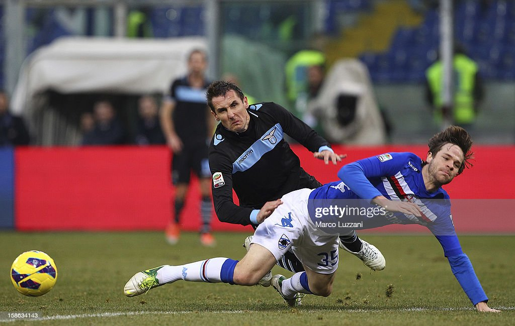 <a gi-track='captionPersonalityLinkClicked' href=/galleries/search?phrase=Miroslav+Klose&family=editorial&specificpeople=206489 ng-click='$event.stopPropagation()'>Miroslav Klose</a> of S.S. Lazio competes for the ball with <a gi-track='captionPersonalityLinkClicked' href=/galleries/search?phrase=Jonathan+Rossini&family=editorial&specificpeople=5780827 ng-click='$event.stopPropagation()'>Jonathan Rossini</a> of UC Sampdoria during the Serie A match between UC Sampdoria and S.S. Lazio at Stadio Luigi Ferraris on December 22, 2012 in Genoa, Italy.
