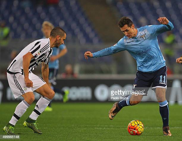 Miroslav Klose of SS Lazio competes for the ball with Leonardo Bonucci of Juventus FC during the Serie A match between SS Lazio and Juventus FC at...