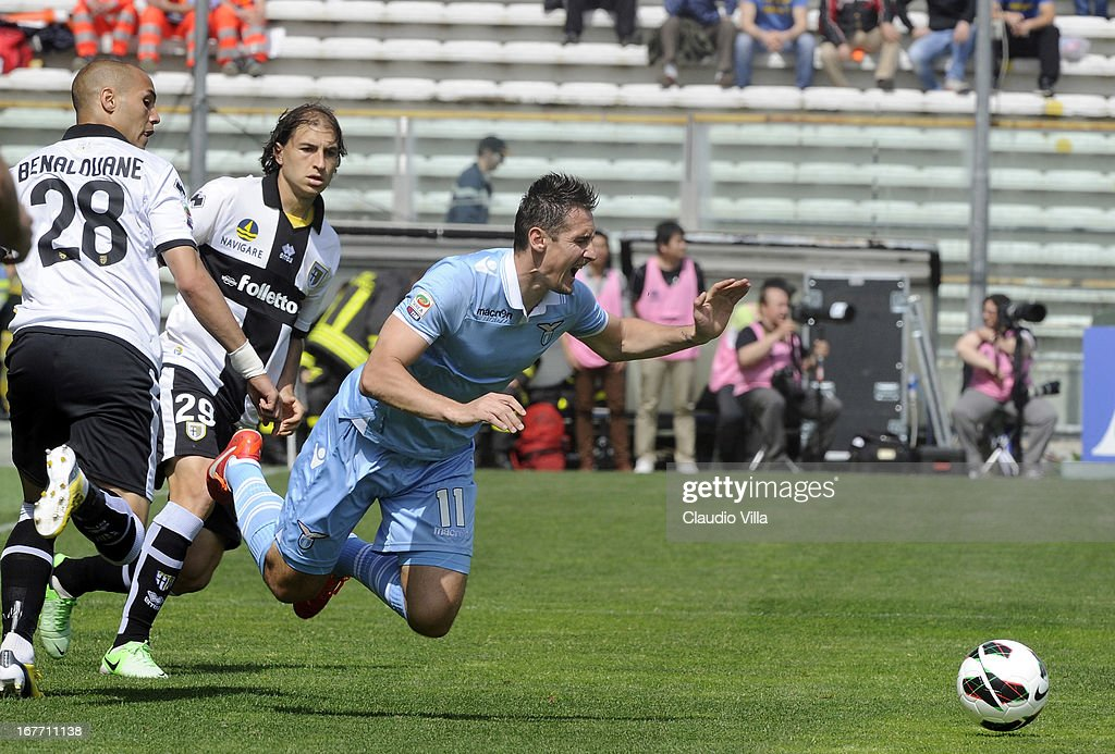 <a gi-track='captionPersonalityLinkClicked' href=/galleries/search?phrase=Miroslav+Klose&family=editorial&specificpeople=206489 ng-click='$event.stopPropagation()'>Miroslav Klose</a> of S.S. Lazio goes down compete for the ball during the Serie A match between Parma FC and S.S. Lazio at Stadio Ennio Tardini on April 28, 2013 in Parma, Italy.