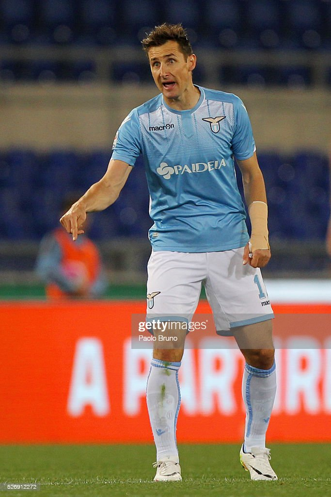 <a gi-track='captionPersonalityLinkClicked' href=/galleries/search?phrase=Miroslav+Klose&family=editorial&specificpeople=206489 ng-click='$event.stopPropagation()'>Miroslav Klose</a> of SS Lazio reacts after scoring the opening goal during the Serie A match between SS Lazio and FC Internazionale Milano at Stadio Olimpico on May 1, 2016 in Rome, Italy.
