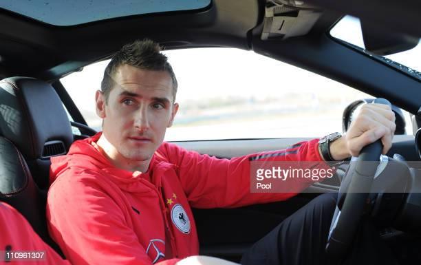Miroslav Klose of team Germany attends a German national team safe driving training lesson of general sponsor MercedesBenz in a SLK 350...