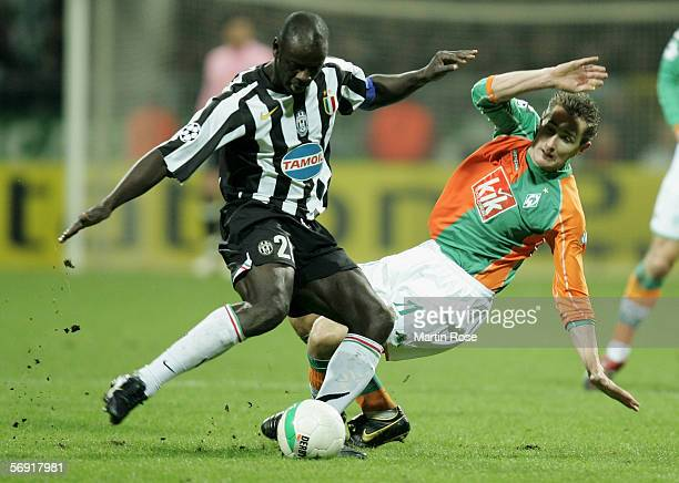 Miroslav Klose of Werder Bremen and Lilian Thuram of Juventus fight for the ball during the UEFA Champions League round sixteen first leg match...
