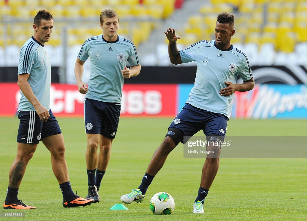 Miroslav Klose, Toni Kroos and Jerome Boateng of Germany in action during a Germany Training Session at Allianz Arena Munich on September 5, 2013 in Munich, Germany.
