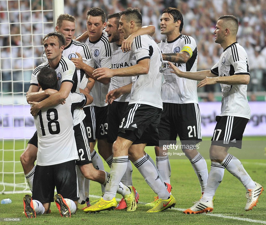 Miroslav Radovic of Legia celebrates after scoring with team mates during the third qualifying round UEFA Champions League match between Legia and Celtic at Pepsi Arena on July 30, 2014 in Warsaw, Poland.