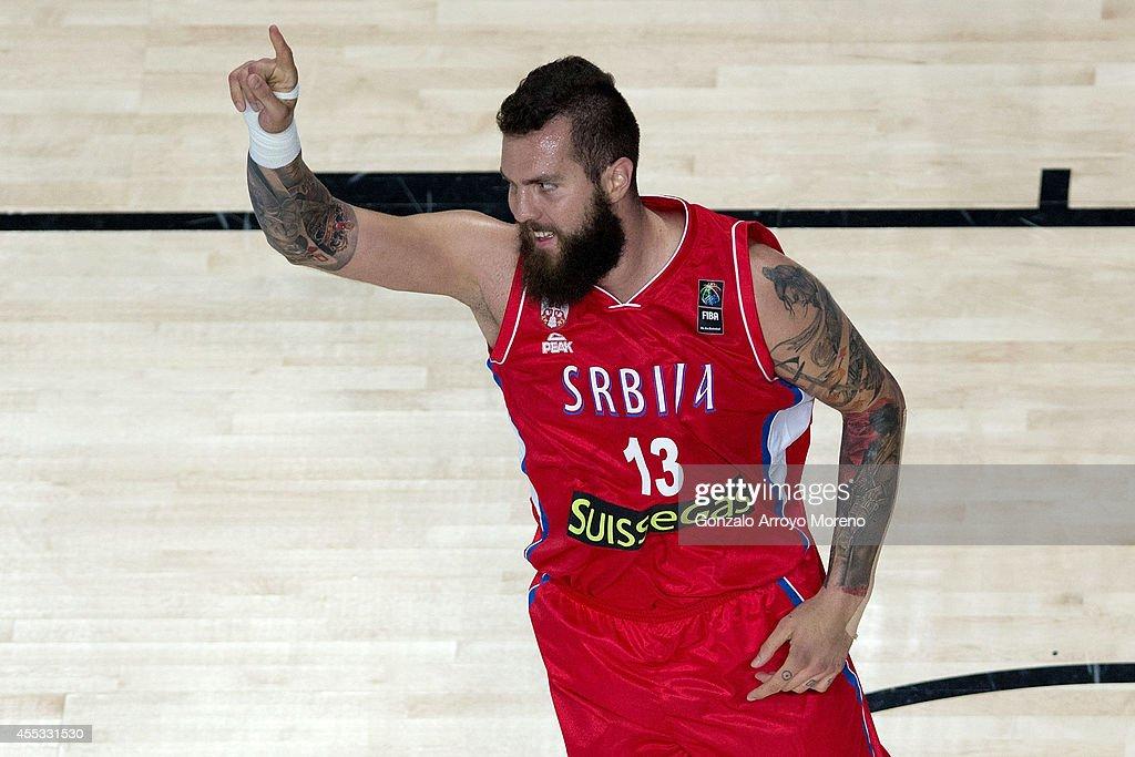 Miroslav Raduljica of Serbia celebrates scoring during the 2014 FIBA World Basketball Championship semifinal match between France and Serbia at...