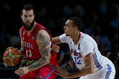 Miroslav Raduljica of Serbia drives against Rudy Gobert of France during the 2014 FIBA World Basketball Championship semifinal match between France...