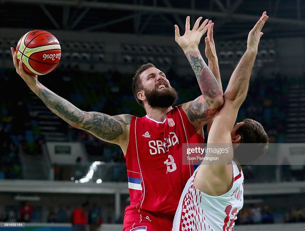Miroslav Raduljica #13 of Serbia drives to the basket against Darko Planinic #12 of Croatia during the Men's Basketball Quarterfinal game at Carioca Arena 1 on Day 12 of the Rio 2016 Olympic Games on August 17, 2016 in Rio de Janeiro, Brazil.