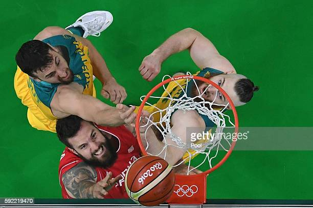 Miroslav Raduljica of Serbia goes to the basket against Andrew Bogut and Aron Baynes of Australia during the Men's Semifinal match on Day 14 of the...