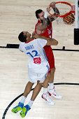 Miroslav Raduljica of Serbia shoots against Rudy Gobert of France during the 2014 FIBA World Basketball Championship semifinal match between France...