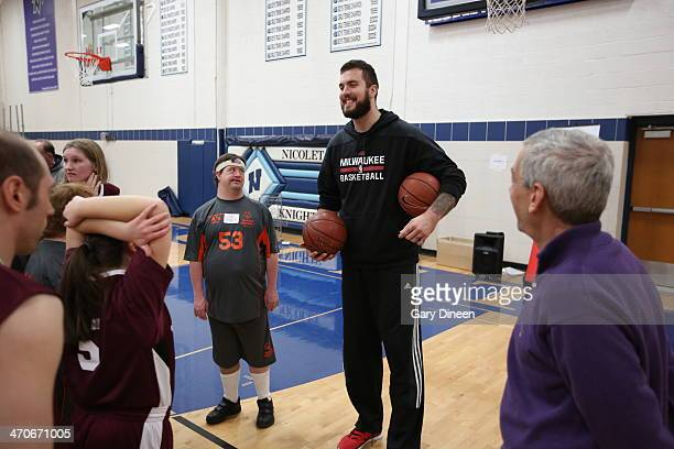 Miroslav Raduljica of the Milwaukee Bucks interacts with participants during a Special Olympics basketball skills clinic on February 11 2014 at...