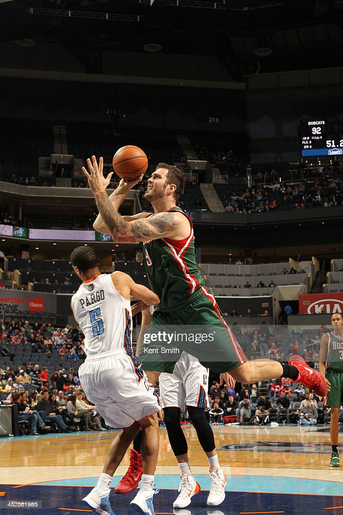 Miroslav Raduljica #9 of the Milwaukee Bucks shoots against Jannero Pargo #5 of the Charlotte Bobcats during the game at the Time Warner Cable Arena on November 29, 2013 in Charlotte, North Carolina.