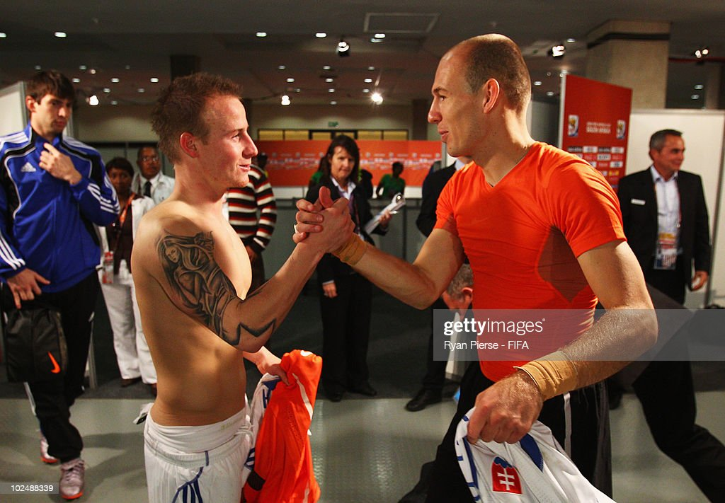 <a gi-track='captionPersonalityLinkClicked' href=/galleries/search?phrase=Miroslav+Stoch&family=editorial&specificpeople=5446681 ng-click='$event.stopPropagation()'>Miroslav Stoch</a> of Slovakia and <a gi-track='captionPersonalityLinkClicked' href=/galleries/search?phrase=Arjen+Robben&family=editorial&specificpeople=194740 ng-click='$event.stopPropagation()'>Arjen Robben</a> of the Netherlands shake hands after the 2010 FIFA World Cup South Africa Round of Sixteen match between Netherlands and Slovakia at Durban Stadium on June 28, 2010 in Durban, South Africa.