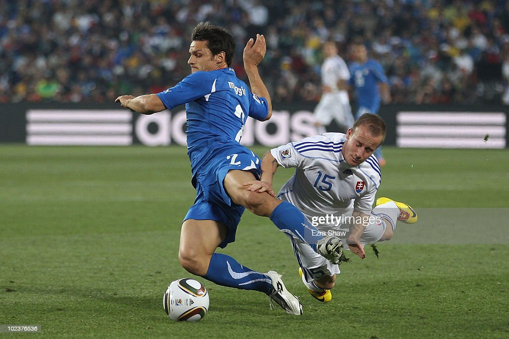 <a gi-track='captionPersonalityLinkClicked' href=/galleries/search?phrase=Miroslav+Stoch&family=editorial&specificpeople=5446681 ng-click='$event.stopPropagation()'>Miroslav Stoch</a> of Slovakia tackles Cristian Maggio of Italy during the 2010 FIFA World Cup South Africa Group F match between Slovakia and Italy at Ellis Park Stadium on June 24, 2010 in Johannesburg, South Africa.