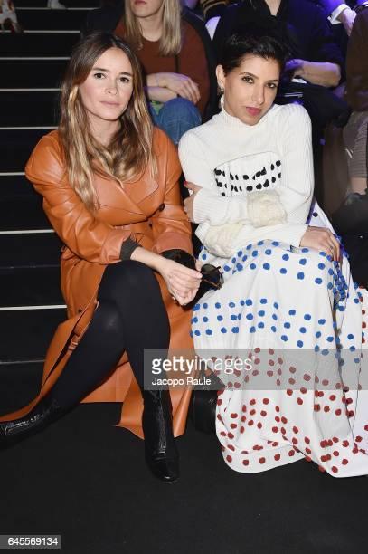 Miroslava Duma and Deena Aljuhani Abdulaziz attend the Dolce Gabbana show during Milan Fashion Week Fall/Winter 2017/18 on February 26 2017 in Milan...